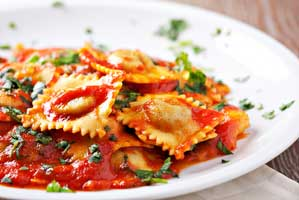 plate of ravioli with a tomato sauce